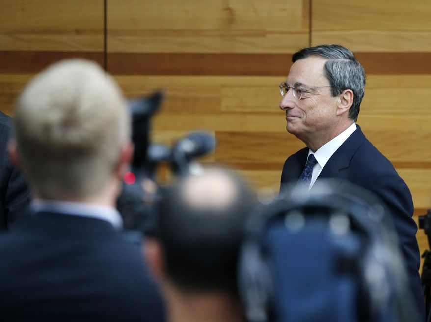 Mario Draghi, president of the European Central Bank, arrives for a news conference in Frankfurt, Germany, on Thursday, Sept. 6, 2012, following a meeting of the ECB governing council concerning further strategies to deal with the European financial crisis. (AP Photo/Michael Probst)