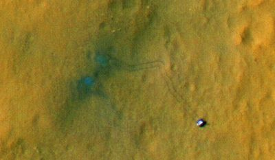 This handout image provided by NASA/JPL-Caltech/Univ. of Arizona, shows tracks from the first drives of NASA's Curiosity rover are visible in this image captured by the High-Resolution Imaging Science Experiment (HiRISE) camera on NASA's Mars Reconnaissance Orbiter. (AP Photo/NASA/JPL-Caltech/Univ. of Arizona)