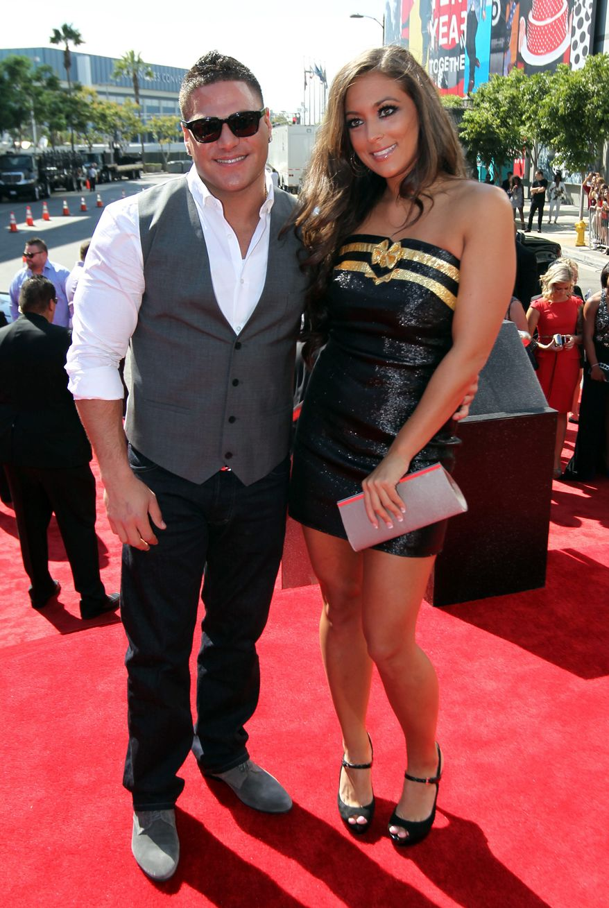 "Ronnie Ortiz-Magro, left, and Samantha Giancola from MTV's ""Jersey Shore,"" arrive at the MTV Video Music Awards on Thursday, Sept. 6, 2012, in Los Angeles. (Photo by Matt Sayles/Invision/AP)"