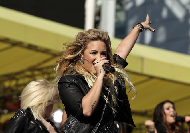 Demi Lovato performs before the MTV Video Music Awards on Thursday, Sept. 6, 2012, in Los Angeles. (Photo by Matt Sayles/Invision/AP)