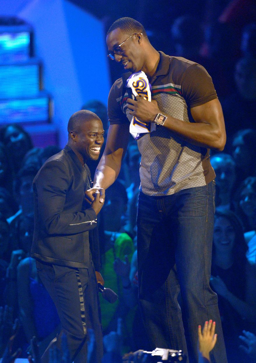 Kevin Hart, left, and Dwight Howard are seen onstage at the MTV Video Music Awards on Thursday, Sept. 6, 2012, in Los Angeles. (Photo by Mark J. Terrill/Invision/AP)