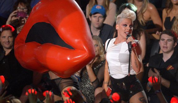 ** FILE ** Pink performs in the audience at the MTV Video Music Awards on Thursday, Sept. 6, 2012, in Los Angeles. (Mark J. Terrill/Invision/AP)