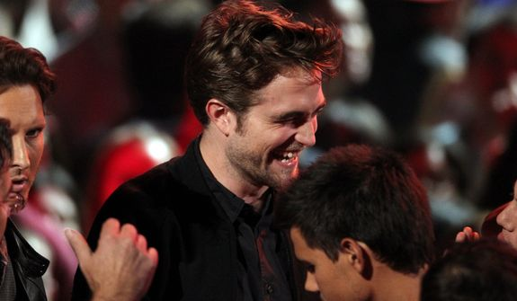 Robert Pattinson smiles onstage at the MTV Video Music Awards on Thursday, Sept. 6, 2012, in Los Angeles. (Photo by Matt Sayles/Invision/AP)