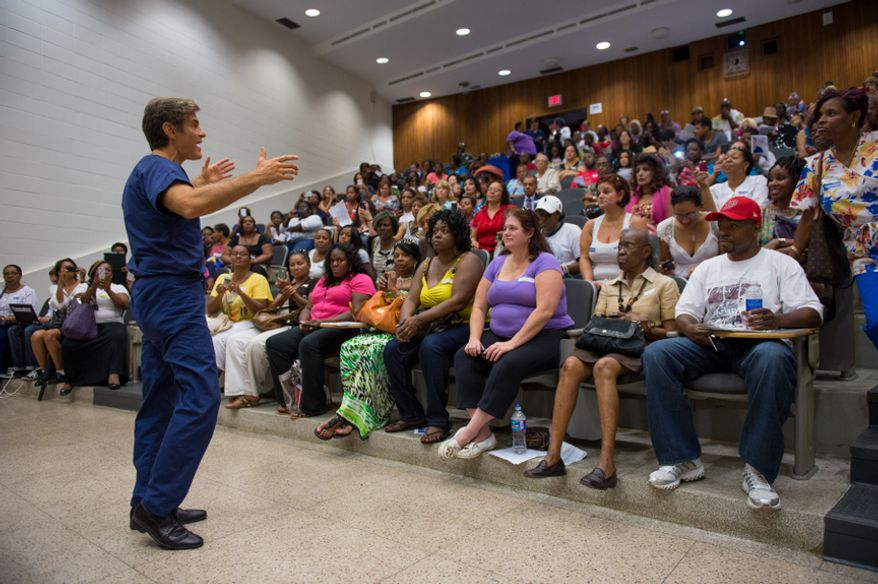 Dr. Mehmet Oz, host of The Dr. Oz Show talks with an auditorium of fans as he hosts a 15-minute clinic open to the public with the help of Howard University medical students to get a very basic idea of people's general risk for heart disease and diabetes at Howard University in the District on Wednesday, Sept. 5, 2012. (Andrew Harnik/The Washington Times)