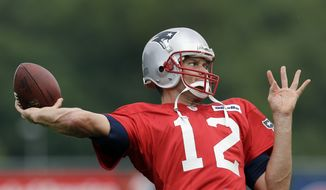 New England Patriots quarterback Tom Brady throws during practice at Gillette Stadium in Foxborough, Mass. Wednesday, Sept. 5, 2012. The Patriots are preparing for their NFL football season opener against the Tennessee Titans on Sunday. (AP Photo/Elise Amendola)