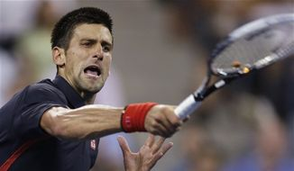 Novak Djokovic returns to Juan Martin del Potro in a quarterfinal of the U.S. Open tennis tournament, Thursday, Sept. 6, 2012, in New York. Djokovic won in straight sets. (AP Photo/Charles Krupa)