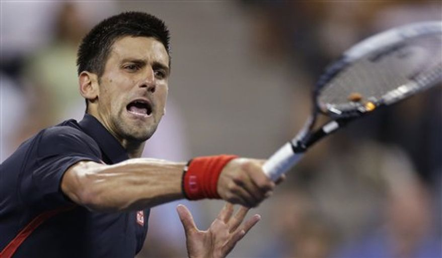 Novak Djokovic returns to Juan Martin del Potro in a quarterfinal of the U.S. Open tennis tournament, Thursday, Sept. 6, 2012, in New York. Djokovic won in straight sets. (AP Photo/Charles Krupa)