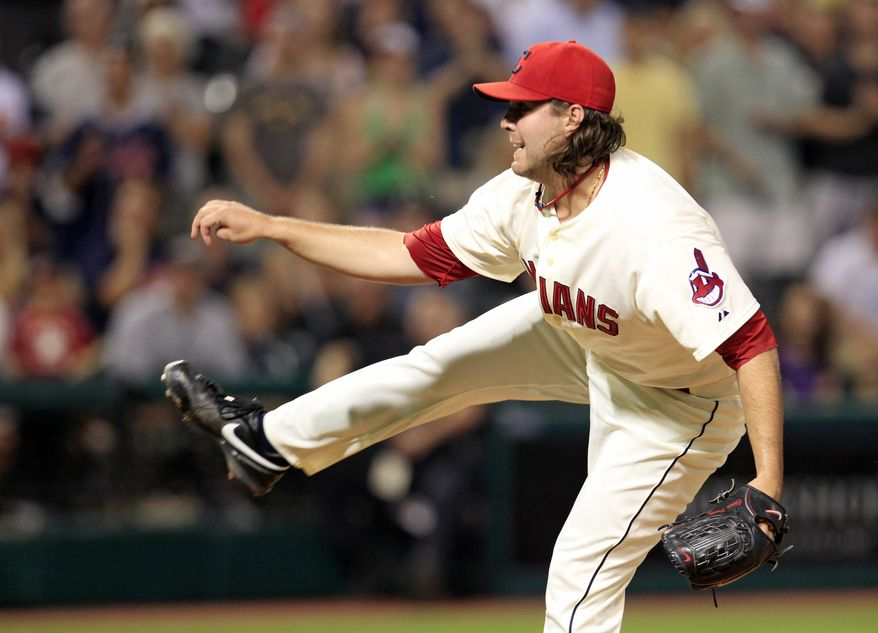 Cleveland Indians relief pitcher Chris Perez follows through on a pitch in the ninth inning of a baseball game against the New York Yankees, Saturday, Aug. 25, 2012, in Cleveland. (AP Photo/Tony Dejak)