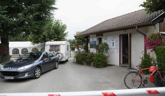 A car drives at the entrance of the campground where the slain British family were holidaying in Saint Jorioz, near Annecy, Thursday, Sept. 6, 2012. A 4-year-old British girl hid for eight hours beneath the bodies of slain family members in the back of their car in a nearby forest, before she was discovered by French investigators who had been guarding the vehicle, a prosecutor said Thursday. (AP Photo/Alexis Moro)