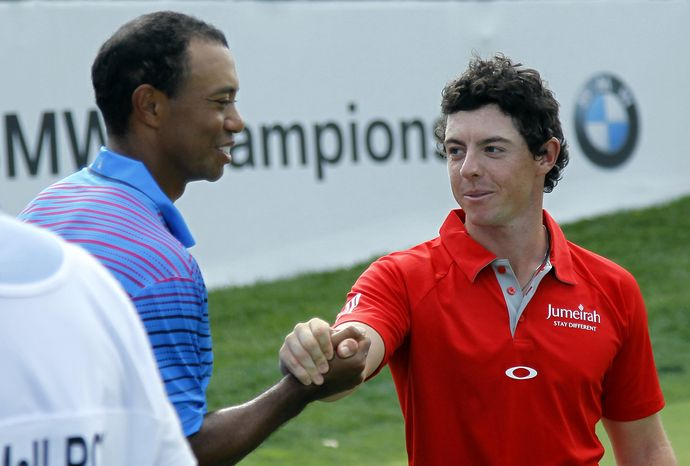 Tiger Woods, left, and Rory McIlroy of Northern Ireland, shake after the first round of the BMW Championship PGA golf tournament at Crooked Stick Golf Club in Carmel, Ind., Thursday, Sept. 6, 2012. (AP Photo/Charles Rex Arbogast)