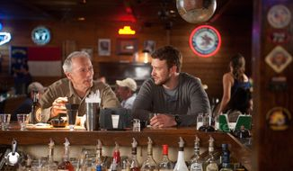 "This film image released by Warner Bros. Pictures shows Clint Eastwood, left, and Justin Timberlake in a scene from ""Trouble with the Curve."" The film, about an aging and ailing baseball scout, will be released on Sept. 21. (AP Photo/Warner Bros. Pictures, Keith Bernstein)"