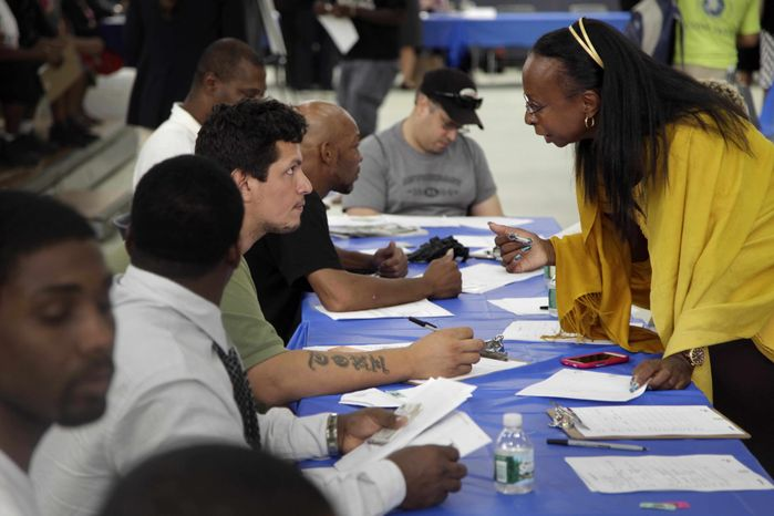 ** FILE ** In this Tuesday, Aug. 21, 2012, file photo, job seekers fill out applications at a construction job fair in New York. (AP Photo/Seth Wenig, File)