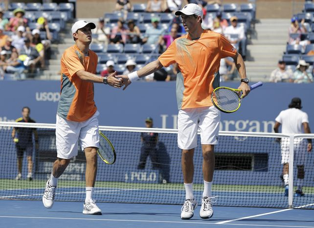 Bob, left, and Mike Bryan react while playing Radek Stepanek of the India's Leander Paes and Czech Republic's Radek Stepanek  during the men's doubles final of the 2012 US Open tennis tournament,  Friday, Sept. 7, 2012, in New York. (AP Photo/Mike Groll)