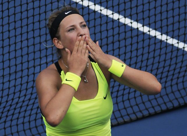 Victoria Azarenka, of Belarus, blows kisses to the crowd after her match against Maria Sharapova, of Russia, during a semifinal match at the 2012 US Open tennis tournament, Friday, Sept. 7, 2012, in New York. Coming all the way back from a set and a break down, the top-seeded Azarenka prevailed in a stirring third, beating four-time major champion Sharapova 3-6, 6-2, 6-4 to reach her first U.S. Open final.  (AP Photo/Charles Krupa)