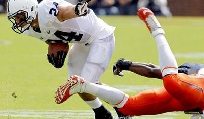 Penn State running back Derek Day (24) breaks a tackle by Virginia's Sammy MacFarlane (44) during the first half of an NCAA college football game, Saturday Sept. 8, 2012, in Charlottesville, Va. (AP Photo/Andrew Shurtleff)