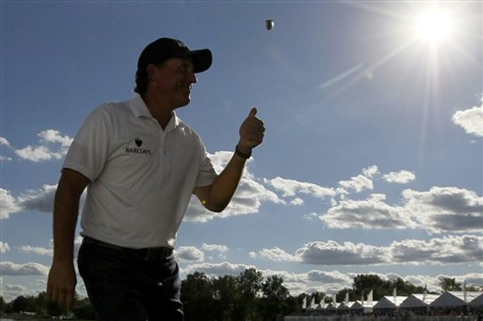 Phil Mickelson acknowledges the crowd with a thumbs-up after he birdied the 18th hole during the third round of the BMW Championship PGA golf tournament at Crooked Stick Golf Club in Carmel, Ind., Saturday, Sept. 8, 2012. (AP Photo/Charles Rex Arbogast)