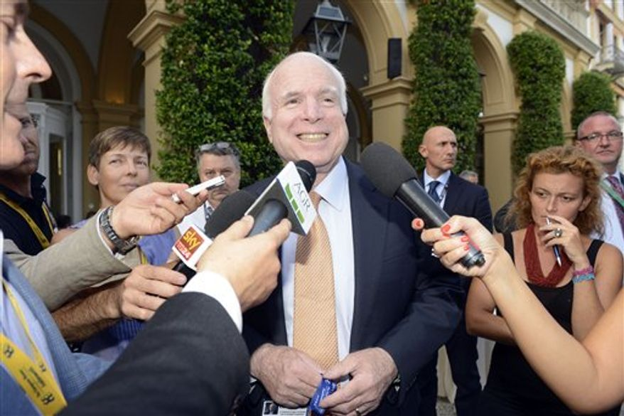 U.S. Sen. John McCain answers reporters' questions during a meeting on World Economy in Cernobbio, Italy, Friday, Sept. 7, 2012. Experts and leaders gathered in Italy to discuss the prolonged crisis in a structurally flawed Europe, political dysfunction pushing America off a 'fiscal cliff' and the emerging economies slowdown drying up the last engine of global growth. (AP Photo/Giuseppe Aresu)