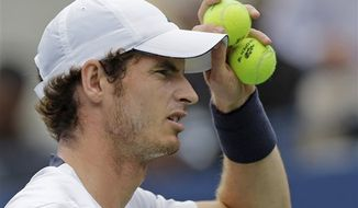 Britain's Andy Murray adjusts his cap while playing Czech Republic's Tomas Berdych during a semifinal match at the 2012 US Open tennis tournament, Saturday, Sept. 8, 2012, in New York. (AP Photo/Mike Groll)