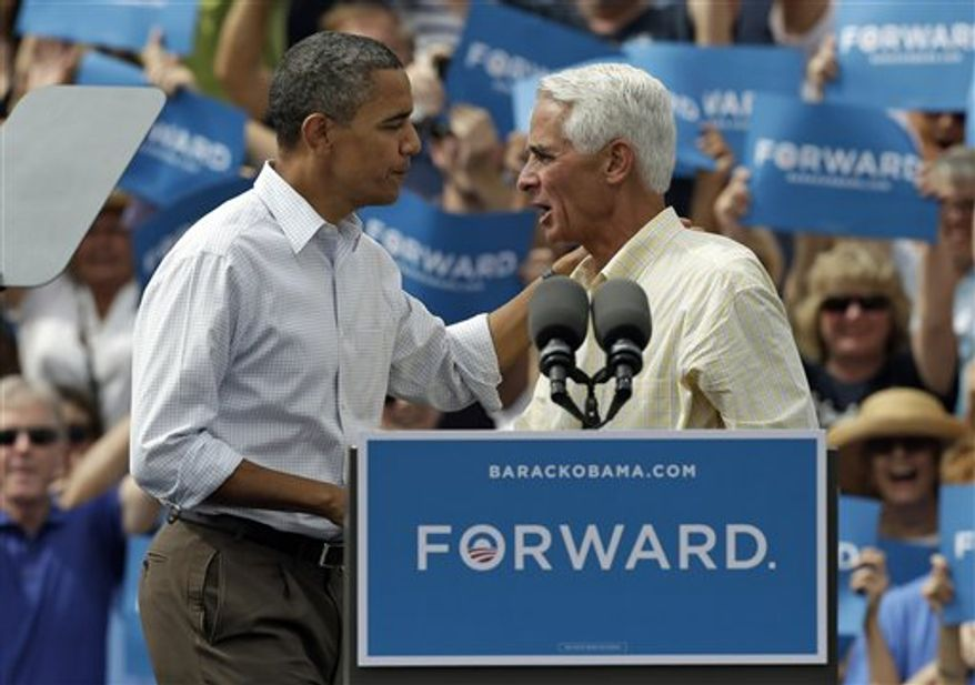 President Obama (left) talks with former Florida Gov. Charlie Crist on Sept. 8, 2012, at a campaign rally in Seminole, Fla. (Associated Press)