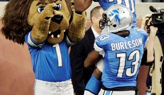 Detroit running back Kevin Smith leaps into the arms of wide receiver Nate Burleson after his 5-yard touchdown catch with 10 seconds left to play lifted the Lions to a 27-23 victory over the St. Louis Rams. (Associated Press)