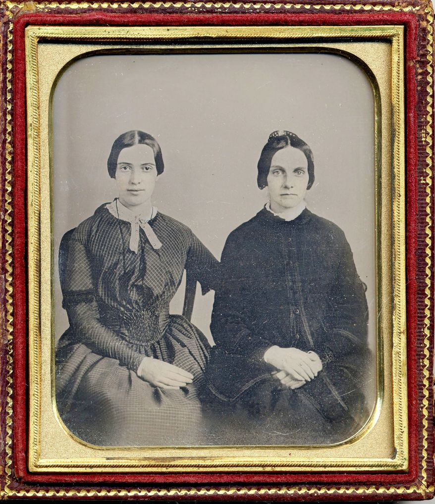 Researchers are trying to prove that this daguerreotype shows a 30-year-old Emily Dickinson (left) with her friend Kate Scott Turner. It would be only the second known photo of the poet. (Associated Press)