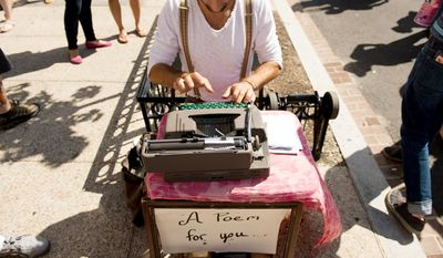 "Ryan Ashley Knowles types out poetry on the streets as part of a project called ""Untouched Poetry"" . (Andrew Harnik/The Washington Times"