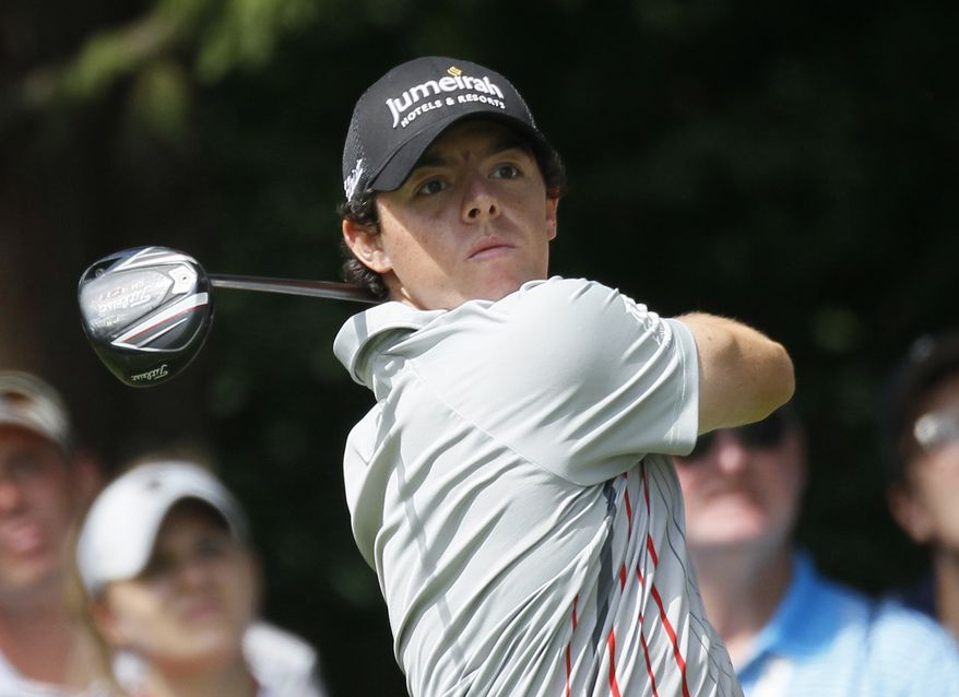 Rory McIlroy, of Northern Ireland, watches his tee shot off the second hole during the final round of the BMW Championship PGA golf tournament at Crooked Stick Golf Club in Carmel, Ind., Sunday, Sept. 9, 2012. (AP Photo/Charles Rex Arbogast)