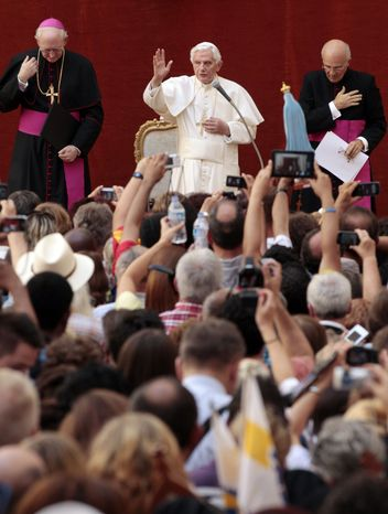 Pope Benedict XVI delivers his blessing during his weekly general audience at his summer residence at Castel Gandolfo, on the outskirts of Rome, on Wednesday, Aug. 22, 2012. (AP Photo/Gregorio Borgia)
