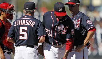 Washington Nationals manager Davey Johnson (5) relieves pitcher Edwin Jackson, second from right, with catcher Kurt Suzuki and first baseman Adam LaRoche, right, also standing on the mound during the fifth inning of a baseball game against the Miami Marlins at Nationals Park, Sunday, Sept. 9, 2012, in Washington. The Marlins won 8-0. (AP Photo/Alex Brandon)