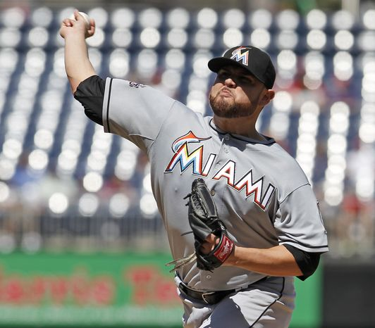Miami Marlins starting pitcher Ricky Nolasco throws during the first inning of a baseball game against the Washington Nationals at Nationals Park, Sunday, Sept. 9, 2012, in Washington. (AP Photo/Alex Brandon)