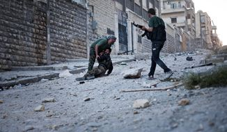 Free Syrian Army soldiers help a severely wounded colleague after he was shot by a Syrian army sniper in the Izaa district of Aleppo, Syria, on Saturday, Sept. 8, 2012. (AP Photo/Manu Brabo)