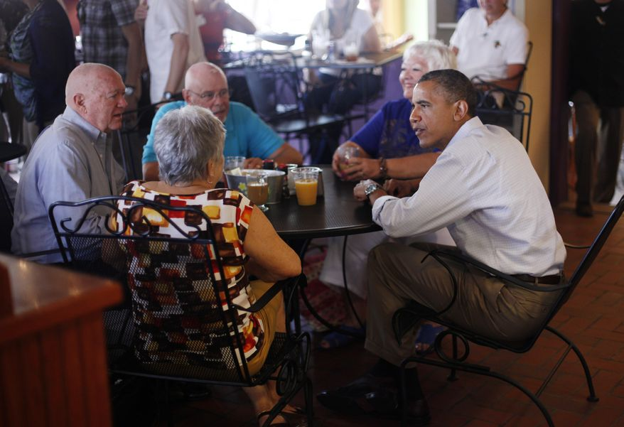 President Obama (right) sits with patrons (from left to right) John and Shirley Hill and Gerry and Jan Clark during his visit to Ossorio Bakery and Cafe in Cocoa, Fla., on Sunday, Sept. 9, 2012. (AP Photo/Pablo Martinez Monsivais)