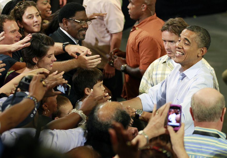 President Obama greets supporters at a campaign event on Sunday, Sept. 9, 2012, in Melbourne, Fla. (AP Photo/John Raoux)