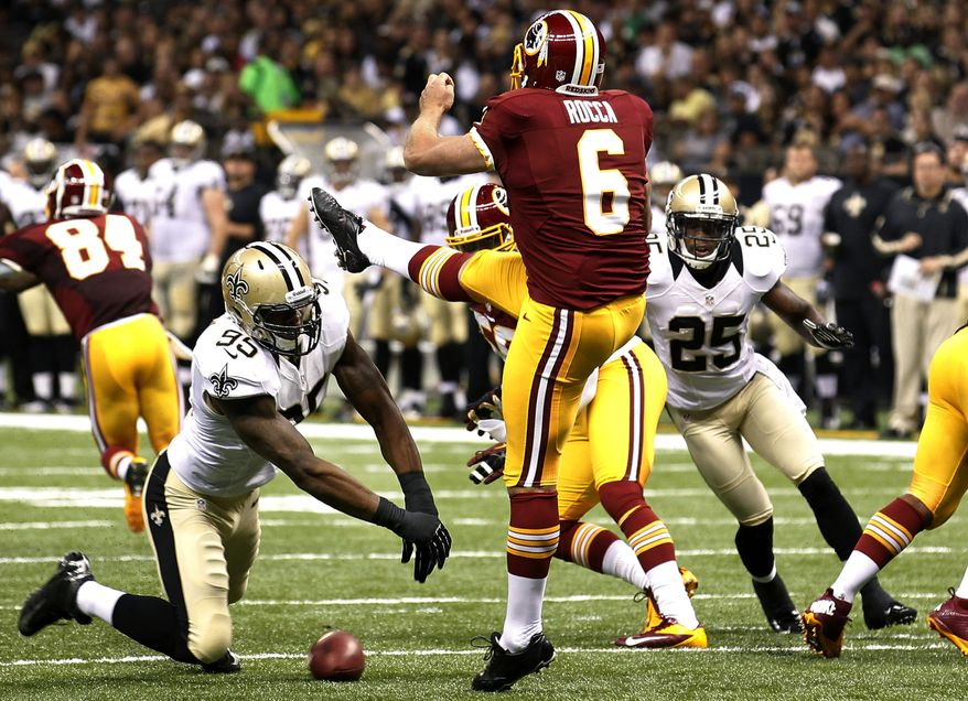 New Orleans Saints defensive end Martez Wilson (95) blocks a punt by Washington Redskins punter Sav Rocca (6) resulting in a Saints touchdown in the first half of an NFL football game in New Orleans, Sunday, Sept. 9, 2012. (AP Photo/Bill Haber)