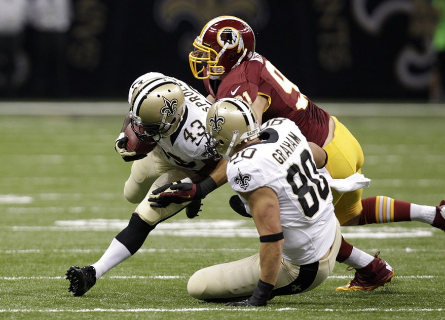 New Orleans Saints running back Darren Sproles (43) rushes in the first half of an NFL football game at the Mercedes-Benz Superdome in New Orleans, Sunday, Sept. 9, 2012. (AP Photo/Matthew Hinton)
