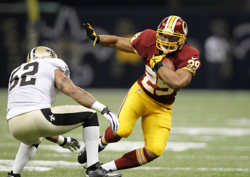 Washington Redskins running back Roy Helu (29) rushes past New Orleans Saints linebacker Jonathan Casillas (52) in the first half of an NFL football game at the Mercedes-Benz Superdome in New Orleans, Sunday, Sept. 9, 2012. (AP Photo/Gerald Herbert)