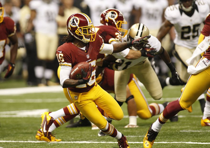 Washington Redskins wide receiver Brandon Banks (16) carries in the first half of an NFL football game at the Mercedes-Benz Superdome in New Orleans, Sunday, Sept. 9, 2012. (AP Photo/Bill Haber)