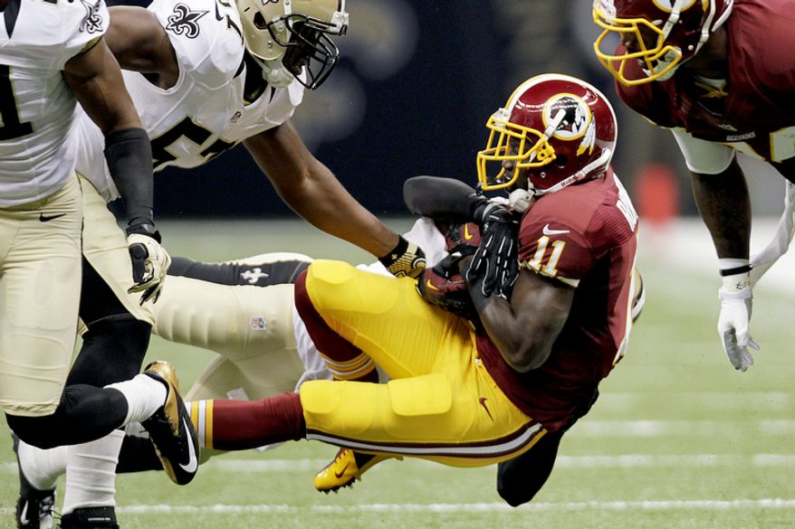 Washington Redskins wide receiver Aldrick Robinson (11) is tackled in the first half of an NFL football game against the New Orleans Saints in New Orleans, Sunday, Sept. 9, 2012. (AP Photo/Gerald Herbert)