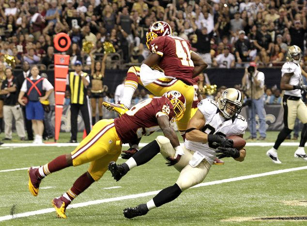 New Orleans Saints tight end Jimmy Graham (80) scores on a touchdown reception in the first half of an NFL football game  against the Washington Redskins at the Mercedes-Benz Superdome in New Orleans, Sunday, Sept. 9, 2012. (AP Photo/Matthew Hinton)