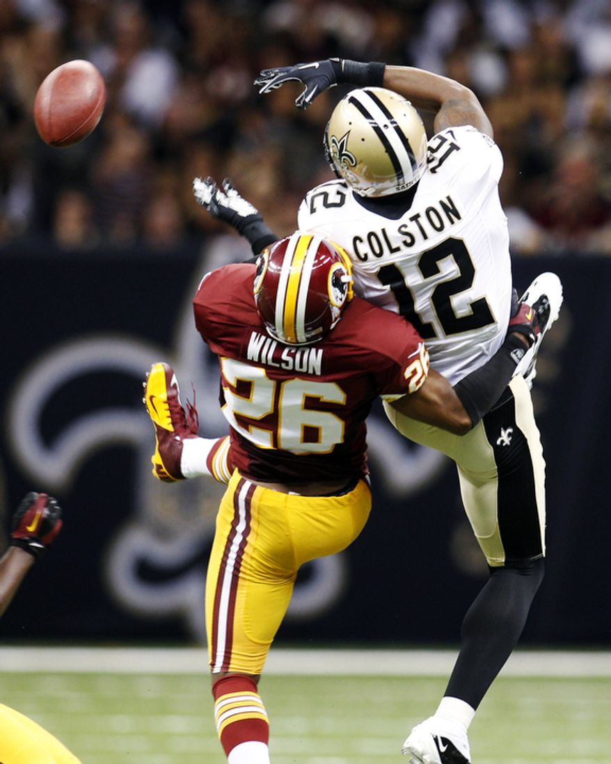 Washington Redskins cornerback Josh Wilson (26) breaks up a pass intended for New Orleans Saints wide receiver Marques Colston (12) in the second half of an NFL football game in New Orleans, Sunday, Sept. 9, 2012. (AP Photo/Bill Haber)