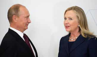 U.S. Secretary of State Hillary Rodham Clinton (right) talks with Russian President Vladimir Putin during the arrival ceremony for the Asia-Pacific Economic Cooperation (APEC) summit in Vladivostok, Russia, on Saturday, Sept. 8, 2012. (AP Photo/Jim Watson, Pool)