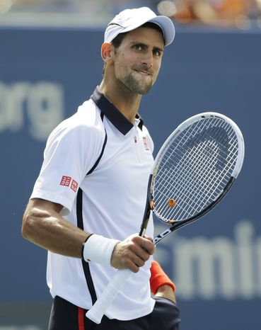 Novak Djokovic of Serbia reacts while playing Spain's David Ferrer during a semifinal match at the 2012 US Open tennis tournament,  Sunday, Sept. 9, 2012, in New York. (AP Photo/Mike Groll)
