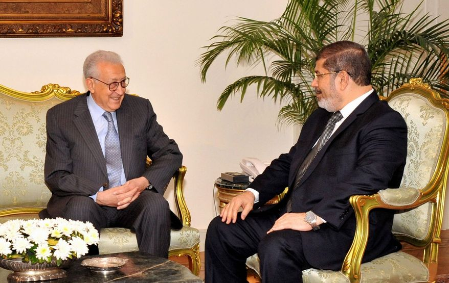 U.N.-Arab League envoy Lakhdar Brahimi ( left) meets with Egyptian President Mohammed Morsi in Cairo on Monday. Mr. Brahimi, who is tasked with brokering a diplomatic solution to the Syrian conflict, replaced Kofi Annan, who stepped down in August in frustration after his six-point peace plan collapsed. Mr. Morsi also is seeking to end the bloodshed in Syria. (Associated Press)