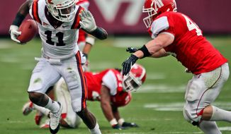 Virginia Tech's Dyrell Roberts (11) rushes away from Austin Peay's Josh Carroll (44)  during an NCAA college football game in Blacksburg, Va., Saturday, Sept. 8, 2012. (AP Photo/The Roanoke Times, Daniel Lin)  LOCAL TV OUT; SALEM TIMES REGISTER OUT; FINCASTLE HERALD OUT;  CHRISTIANBURG NEWS MESSENGER OUT; RADFORD NEWS JOURNAL OUT; ROANOKE STAR SENTINEL OUT