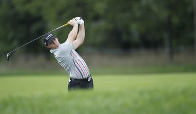 Rory McIlroy of Northern Ireland hits an approach shot to the fifth green during the final round of the BMW Championship PGA golf tournament at Crooked Stick Golf Club in Carmel, Ind., Sunday, Sept. 9, 2012. (AP Photo/Charles Rex Arbogast)