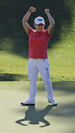 Jiyai Shin, of South Korea, celebrates winning the Kingsmill Championship LPGA Tour golf tournament in Williamsburg, Va., Monday, Sept. 10, 2012. Shin won the tournament in a nine-hole playoff with Paula Creamer. (AP Photo/Steve Helber)