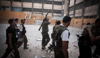 **FILE** FSA soldiers go to the front line in Izaa district in Aleppo, Syria, on Sept. 9, 2012. (Associated Press)
