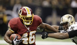 Washington Redskins running back Alfred Morris (46) rushes in the second half of an NFL football game against the New Orleans Saints at the Mercedes-Benz Superdome in New Orleans, Sunday, Sept. 9, 2012. (AP Photo/Matthew Hinton)