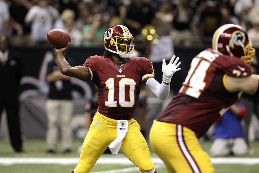 Washington Redskins quarterback Robert Griffin III (10) passes in the second half of an NFL football game against the New Orleans Saints at the Mercedes-Benz Superdome in New Orleans, Sunday, Sept. 9, 2012. (AP Photo/Matthew Hinton)