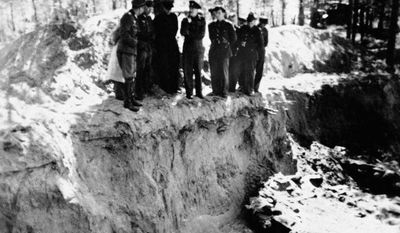 **FILE** A group of American and British POWs being held by the Germans, including Lt. Col. John H. Van Vliet Jr. and Capt. Donald B. Stewart, look over a mass grave where murdered Polish officers are buried, near Smolensk, Russia, in May 1943. The Soviet secret police killed the Poles in 1940, hoping to eliminate an elite that would have resisted Soviet control of Poland. Van Vliet and Stewart were among a group of British and American prisoners forced to see the horrifying site by the Germans, who wanted word to get out to the world of the Soviet atrocity. (Associated Press)